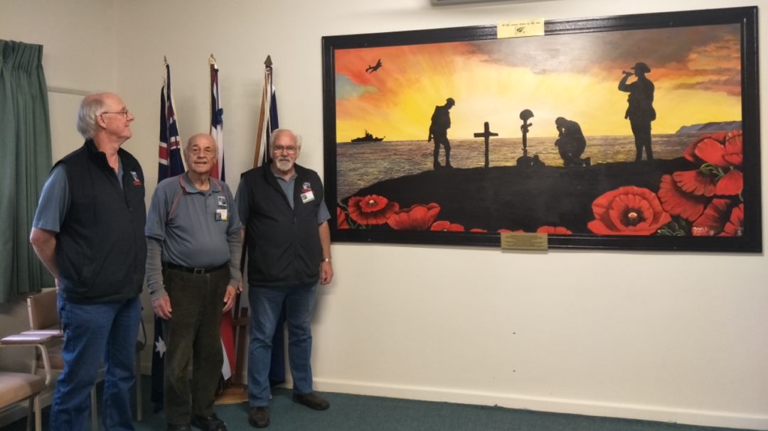 men with ANZAC artwork that is framed by them